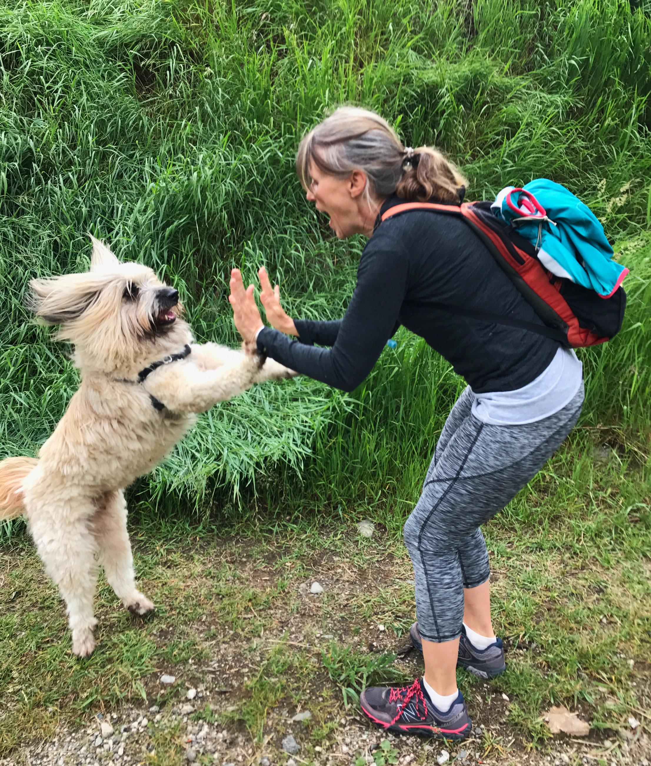 Kimberley-Hyatt-Nelson-BC-high five with dog