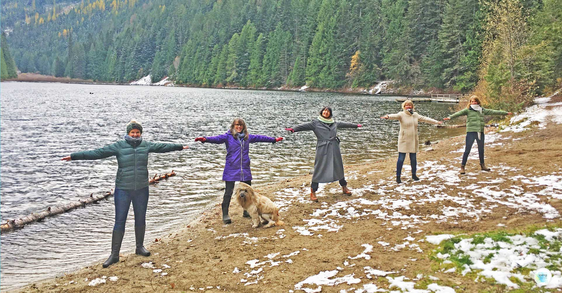 Spring Creative Team holds hands at Cottonwood-Lake